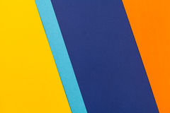 Color papers background. Color papers geometry flat composition background with yellow blue and oranges tones Stock Images