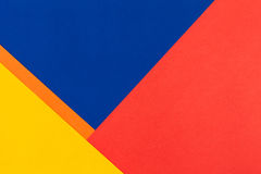 Color papers background. Color papers geometry flat composition background with yellow orange red and blue tones Royalty Free Stock Photo