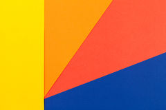 Color papers background. Color papers geometry flat composition background with yellow orange red and blue tones Royalty Free Stock Images