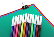 Color papers, black clip and felt-tip pen Stock Photos