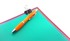 Color papers, clip and pen Royalty Free Stock Images
