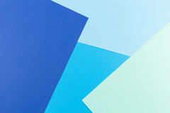 Color papers geometry flat composition background with blue tones Royalty Free Stock Image