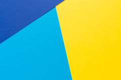 Color papers geometry flat composition background with yellow and blue tones Royalty Free Stock Photos