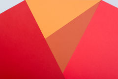Color papers geometry flat composition background with pink,red, Stock Image
