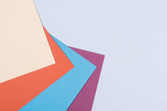 Color papers geometry flat composition background with violet, b Stock Photos