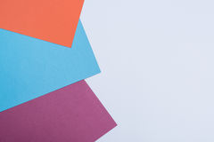 Color papers geometry flat composition background with violet, b Stock Photo