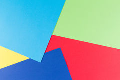 Color papers geometry flat composition background with yellow, green, red and blue tones Stock Image