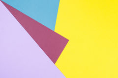 Color papers geometry flat composition background with yellow, r Stock Images