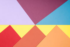 Color papers geometry flat composition background with yellow, r Stock Image