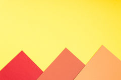 Color papers geometry flat composition background with yellow, r Royalty Free Stock Images