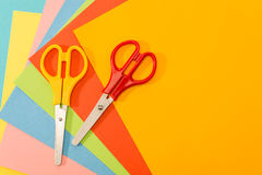 Color papers with scissors paperwork art Stock Photography