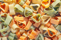 Color pasta with heart shape Stock Images