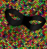 Color patterned background and mask. Abstract colored background image consisting of lines and cubes with carnival black half mask Stock Image