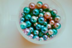 Color pearl beads. Set of colored pearl beads in a box royalty free stock photo