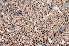 Color pebble stone. In background Stock Image