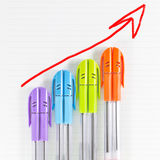 Color pen business graph. With arrow showing profits and gains Royalty Free Stock Photo