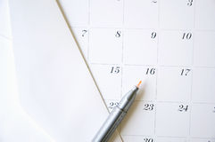 Color pen on calendar. Yelllow pen point to the date and envelope on calendar Royalty Free Stock Photos