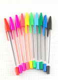 Color pen on the checked paper Royalty Free Stock Photo