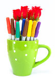 Color pen and rose in cup Stock Photography