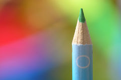 Color pencil. Close-up of color pencil on a multicolored background stock image