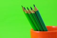 Color Pencil. Colored Pencils In Cup on green background Royalty Free Stock Photography