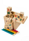Color pencil arrange under wooden alphabet block Stock Photography