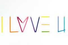 Color pencil as word  I LOVE U  on the white background. Stock Photos