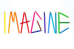 Color pencil as word  IMAGINE on the white background. Stock Image