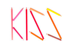 Color pencil as word  KISS  on the white background. Royalty Free Stock Photos