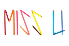 Color pencil as word  MISS U  on the white background. Royalty Free Stock Image