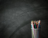 Color pencil and black wall Royalty Free Stock Photos