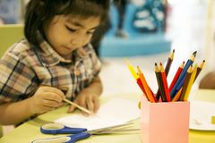 Color pencil with equipment in art classroom. Focus color pencil with equipment in box on table in kid art classroom stock photography