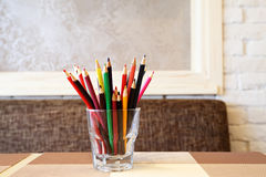 Color pencil in the glass Stock Photos