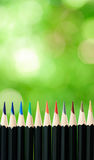 Color pencil on green bokeh Royalty Free Stock Photo