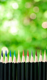 Color pencil on green bokeh Royalty Free Stock Photos