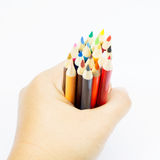 Color pencil in hand Royalty Free Stock Photos