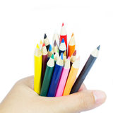 Color pencil in hand on white Royalty Free Stock Photos
