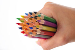 Color pencil in hand Stock Photo