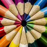 Color Pencil. Image of a color pencil pointing to the middle with black background Royalty Free Stock Photos