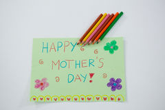 Color pencil kept on happy mothers day greetings card Royalty Free Stock Photo