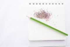 Color pencil and a notebook. On white background, idea for advertise, publishing information, design or making postcard, calendar stock photography