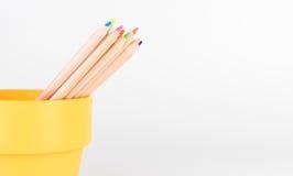 Color Pencil in orange bucket Royalty Free Stock Photo