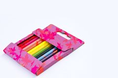 Autumn Color pencil in pink box on white background stock photos