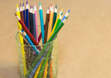 Color Pencil set. In a glass container on craft paper Royalty Free Stock Photo