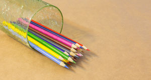 Color Pencil set. In a glass container on craft paper Stock Photo