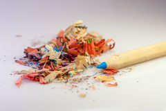 Color pencil and sharpener residue Royalty Free Stock Photos