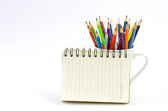 Color pencil and sketchbook on white background. Royalty Free Stock Photos