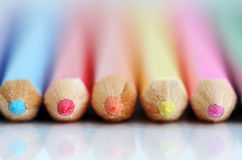 Color pencil tips. A row of color pencil fronts with reflection. Shallow DOF with only tips sharp stock images