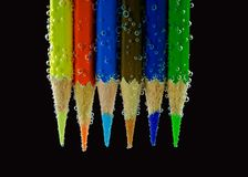 Color pencil under water on black Stock Photography