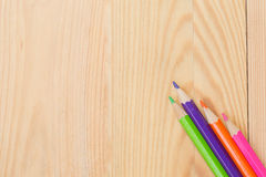 Color pencil on wood table background. Stock Photography